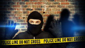Surprised burglar stopped because of blue police light Stock Photos