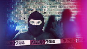 Surprised burglar stopped. Because of blue police light and take his hands up royalty free stock photo