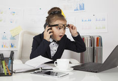 Surprised business girl in the office Stock Image