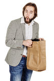 Surprised business man with paper bag. human emotion expression. Portrait of bearded surprised business man with paper bag. human emotion expression and stock photo