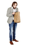 Surprised business man with paper bag. human emotion expression. Portrait of bearded surprised business man with paper bag. human emotion expression and stock photos