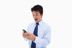 Surprised business man reading a text message Stock Images