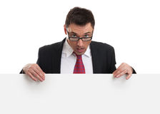 Surprised business man showing blank billboard Royalty Free Stock Photography