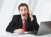 Surprised business man talking on phone royalty free stock images