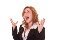 Surprised business woman. Surprised young blond woman standin in black suit with her hands up Royalty Free Stock Photo