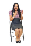 Surprised business woman on chair stock image
