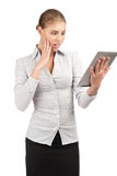 Surprised business woman with electronic tablet Royalty Free Stock Images