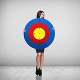 Surprised business woman holding big target Stock Image