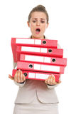 Surprised business woman holding stack of folders Stock Photography
