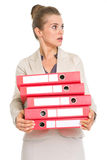 Surprised business woman holding stack of folders Royalty Free Stock Photos