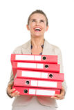 Surprised business woman holding stack of folders Royalty Free Stock Images