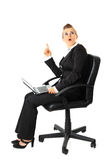 Surprised business woman with laptop got idea. Sitting on chair with  laptop  surprised modern business woman got idea isolated on white Royalty Free Stock Photography
