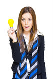 Surprised Business Woman With Lightbulb Solution Stock Photo