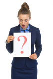 Surprised business woman looking on paper sheet Royalty Free Stock Photo