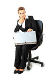 Surprised business woman looking in suitcase. Sitting on chair surprised modern business woman looking in suitcase  isolated on white Royalty Free Stock Photography