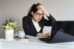 Surprised  business woman in office Stock Photo