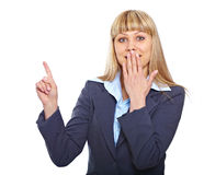 Surprised business woman pointing Stock Photography
