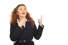 Surprised business woman pointing up Stock Photos
