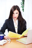 Surprised business woman reading files Stock Photo