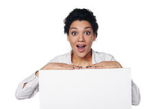 Surprised business woman showing blank credit card Royalty Free Stock Photography