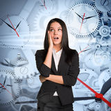 Surprised businesslady with clocks Stock Photo