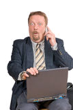 Surprised businessman. Traveling businessman or salesman with laptop calling, and receiving amazing or startling news. Isolated over white Royalty Free Stock Images