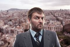 Surprised businessman against the city Stock Photo