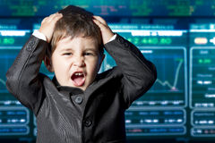Surprised businessman child in suit, stock marke Royalty Free Stock Images