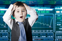 Surprised businessman child in suit, stock marke Stock Photography