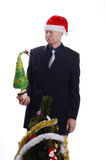 Surprised Businessman with christmas tree. Man looking at Christmas tree on white Stock Image