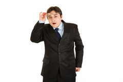 Surprised businessman with eyeglasses in hand Royalty Free Stock Photos