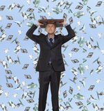 Surprised businessman and flying dollar. Banknotes against blue sky Stock Images