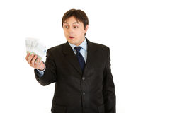 Surprised businessman holding money in his hand Royalty Free Stock Photo