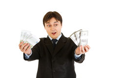 Surprised businessman holding money in his hand Stock Image