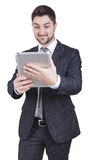 Surprised businessman holding tablet Stock Photos