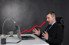 Surprised businessman and line graph Stock Photography