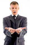 Surprised businessman looking at his palms Royalty Free Stock Photos