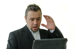 Surprised businessman looking at tablet screen Royalty Free Stock Photography
