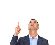Surprised businessman pointing upward Stock Photos