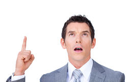 Surprised businessman pointing upward Royalty Free Stock Photo