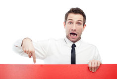 Surprised businessman with red sign Stock Images