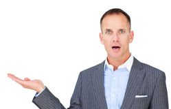 Surprised businessman showing a copy space Stock Photography