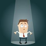 Surprised businessman in spotlight Stock Photos