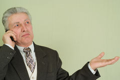 Surprised businessman talking on the phone Stock Photography