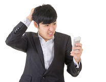 Surprised businessman use cellphone Stock Photography