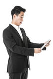 Surprised businessman using a tablet Stock Image