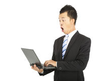 Surprised businessman watching the laptop Royalty Free Stock Image