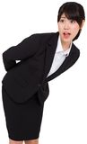 Surprised businesswoman bending Stock Photography