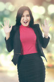 Surprised businesswoman with blur background. Portrait of beautiful businesswoman looks surprised, shot with bokeh background Royalty Free Stock Photo