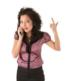 Surprised businesswoman calling by cellphone Royalty Free Stock Photos